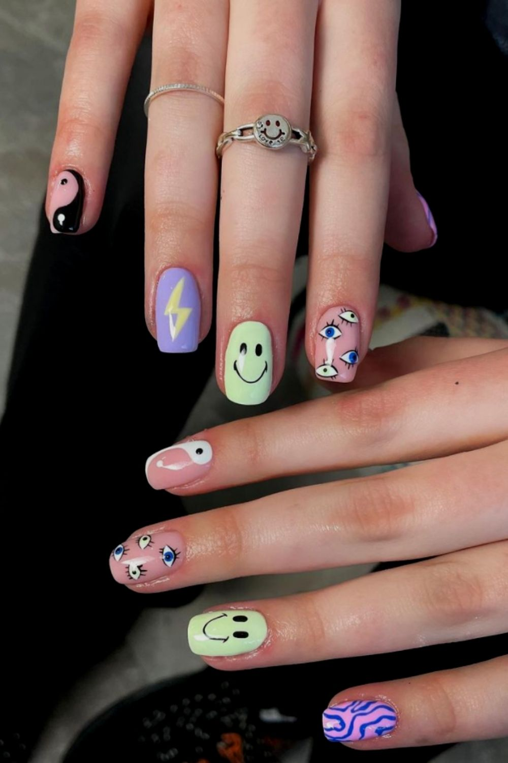 Short nails designs with smiling faces and eyes