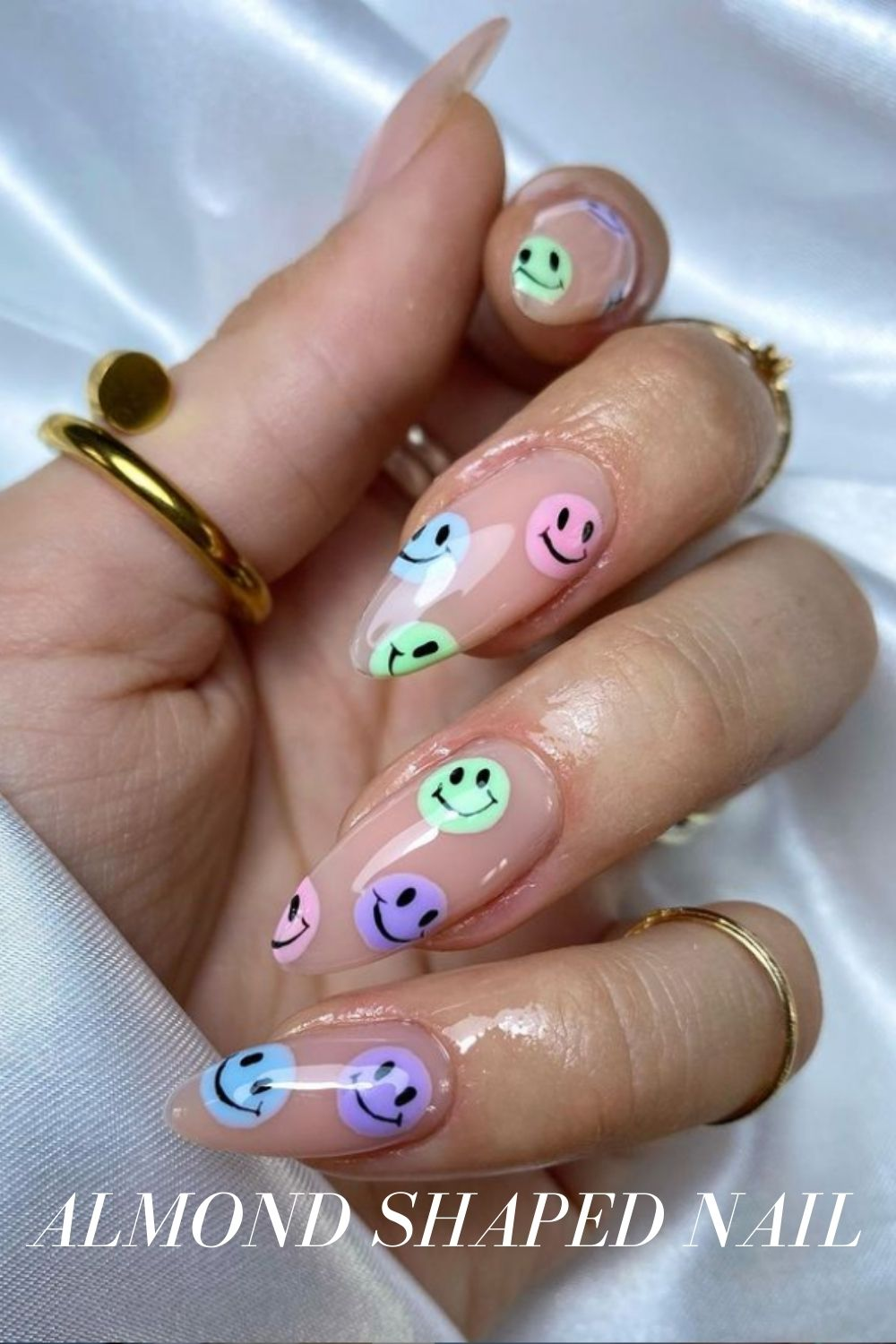 Almond nail design with smiley face
