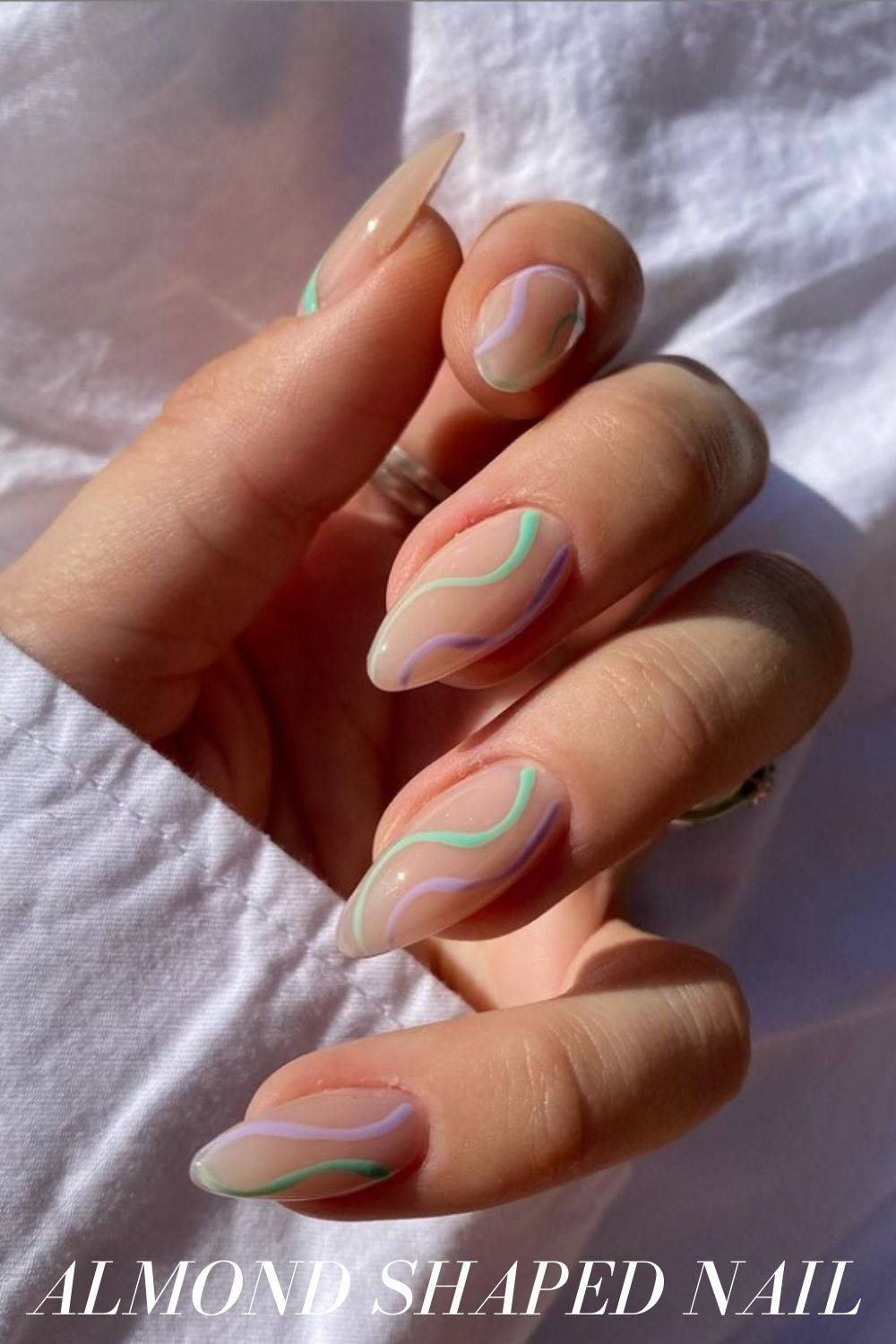 Green, pink and purple almond nails