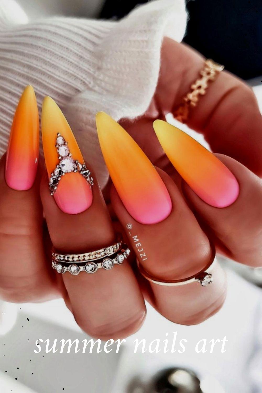 Orange stiletto nails with diamond