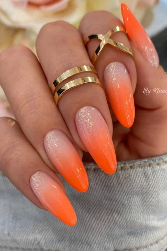 Glitter orange almond nails designs