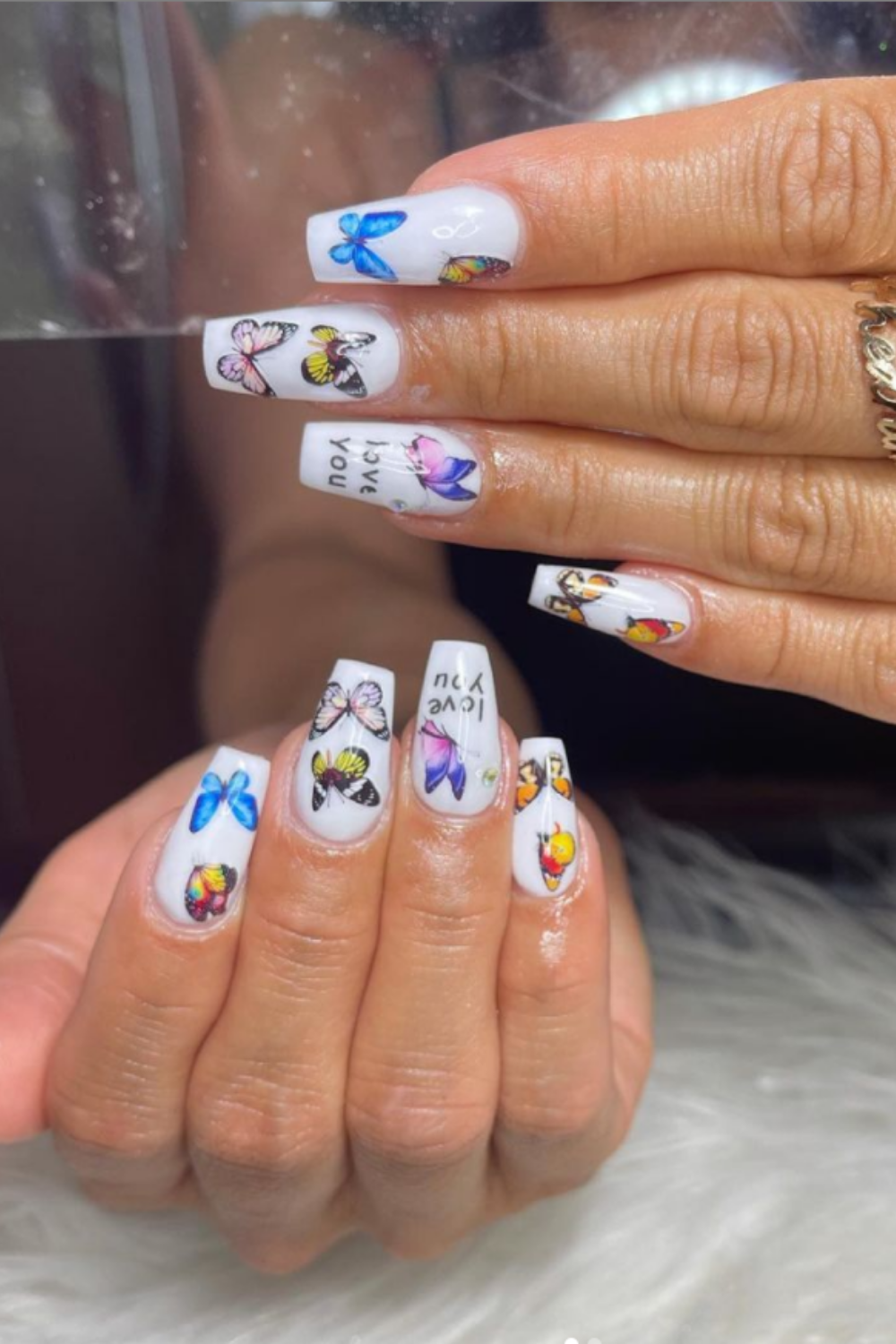 French manicure with elegant butterfly nail art
