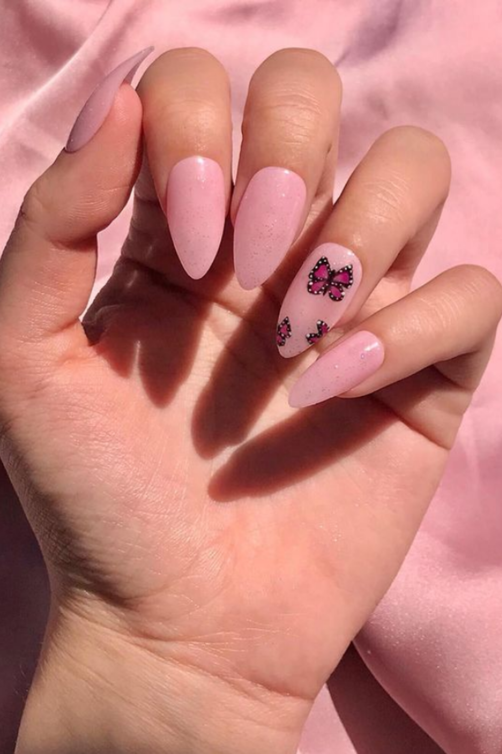 Pink almond nails with butterfly