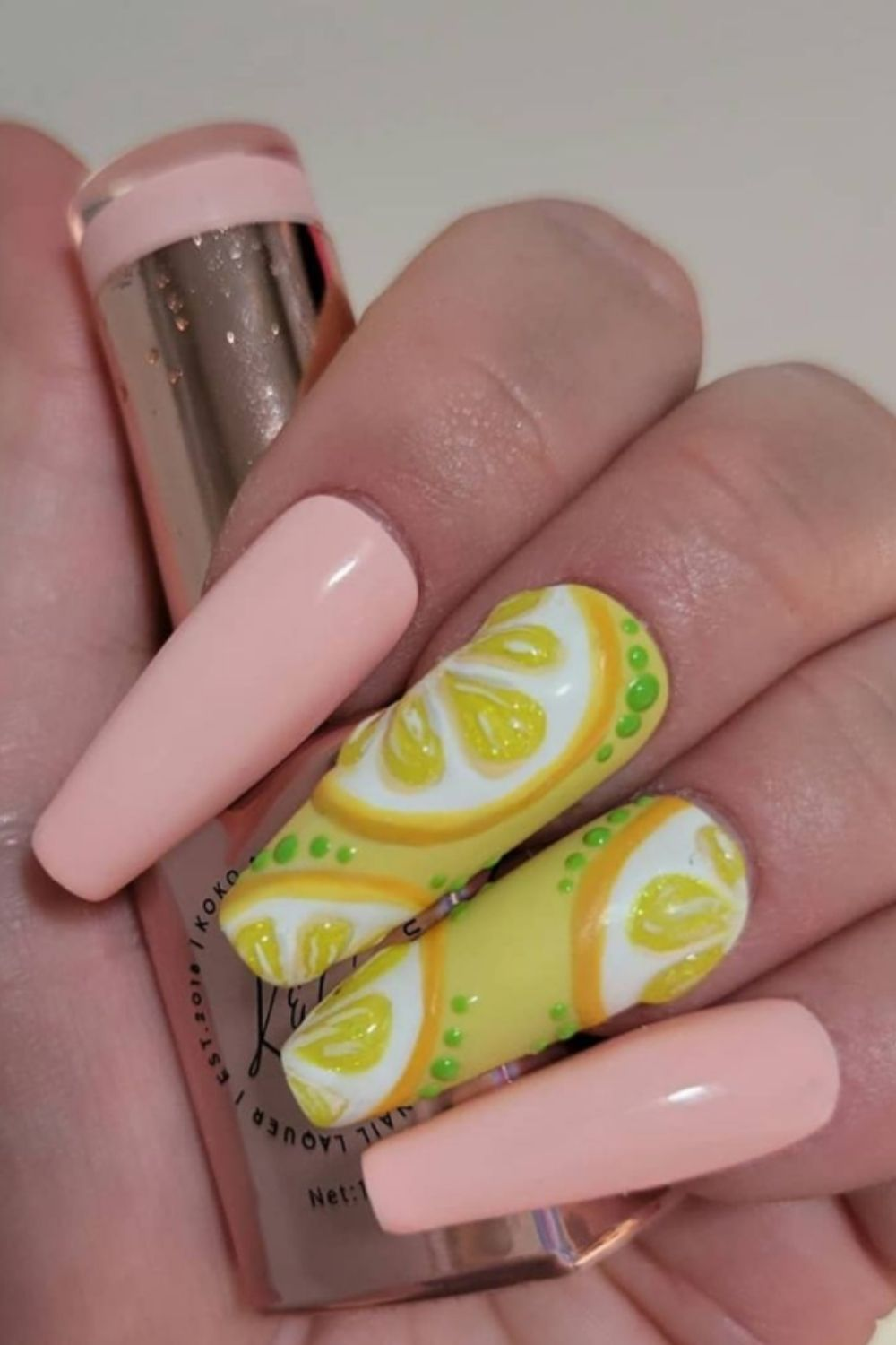 Pink and yellow coffin nail with lemon