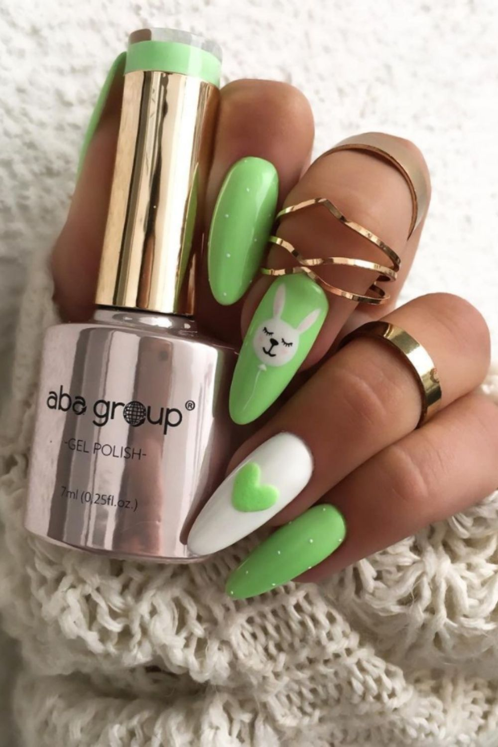 Green  and white almond-shaped nails with heart