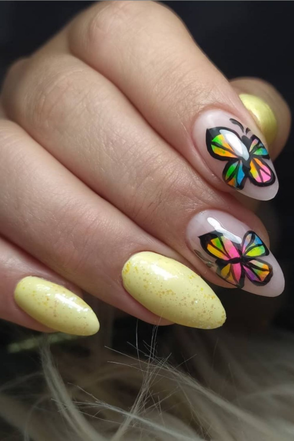 Yellow almond nails with butterfly