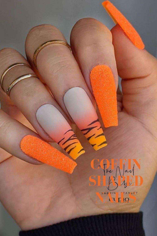 Glitter orange coffin nail design