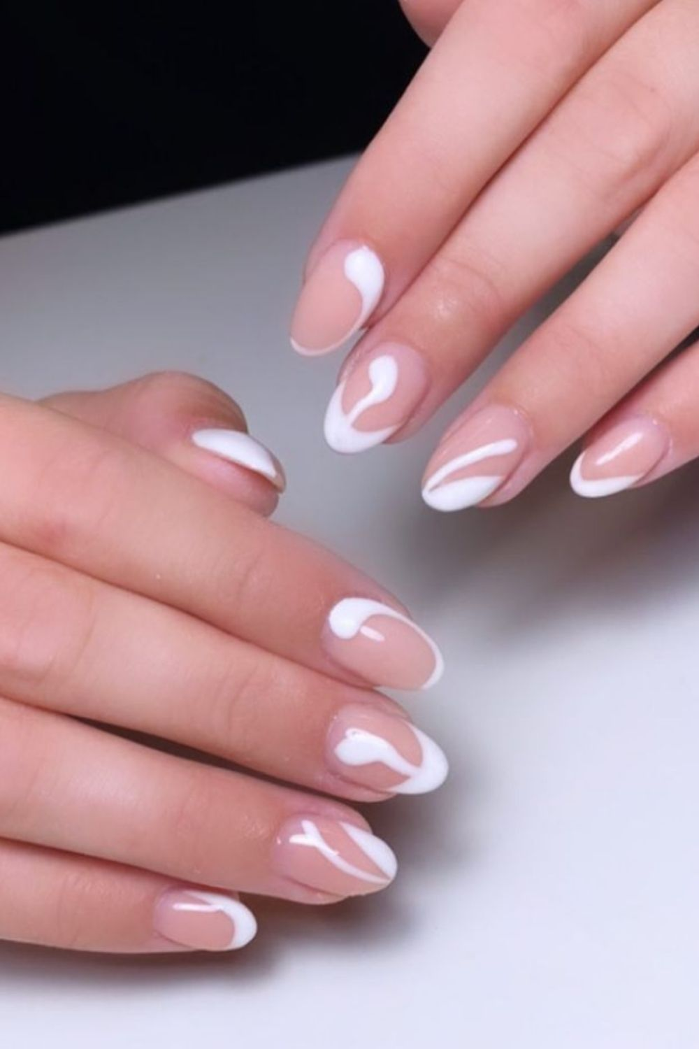 Pink and white almond-shaped nails designs