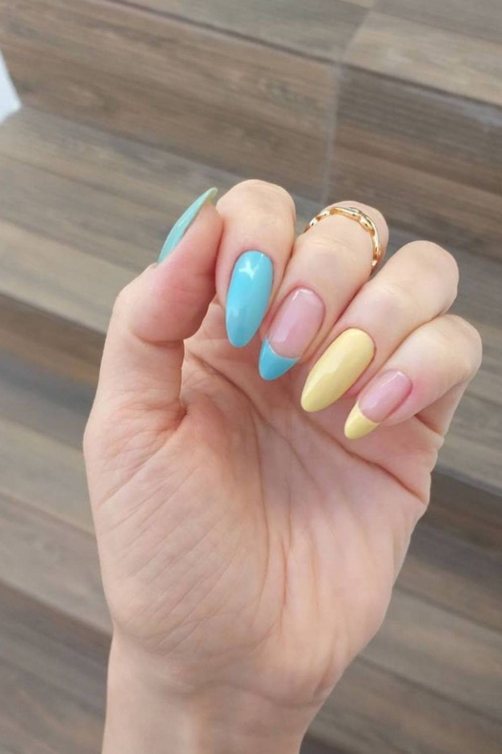 Yellow and blue almond nails