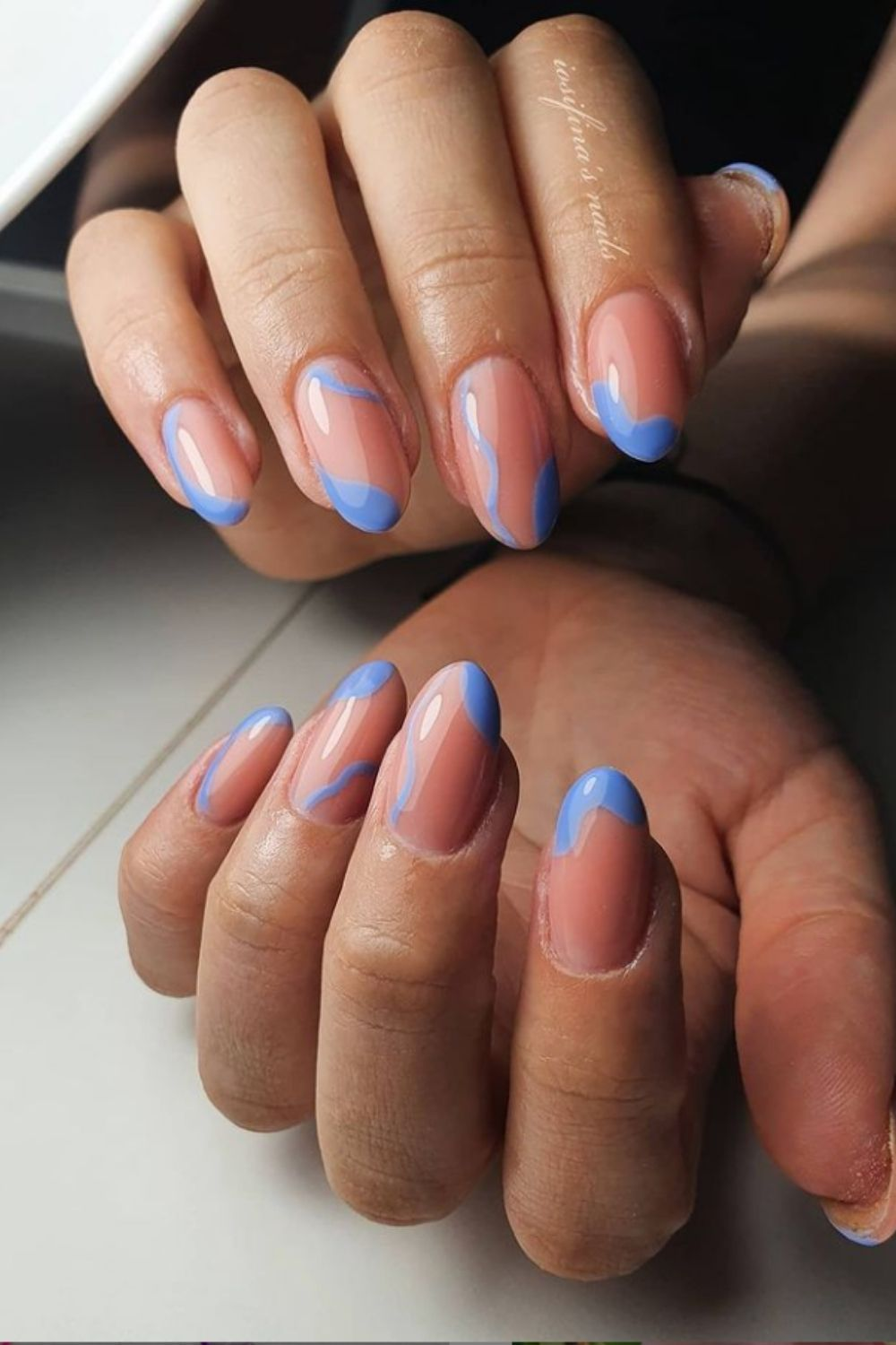 Light blue and nude almond-shaped nails art