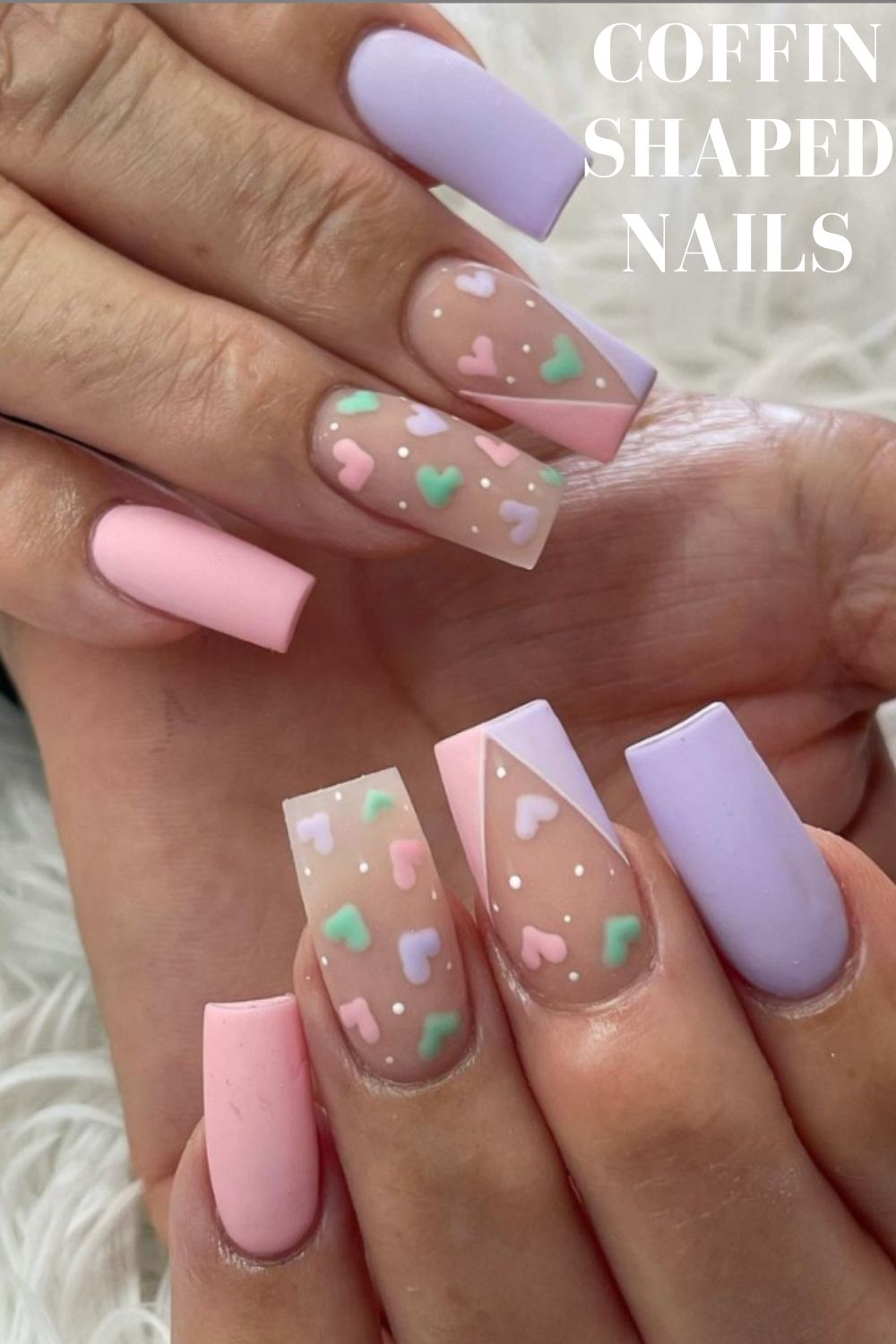Purple and pink coffin nail design with heart