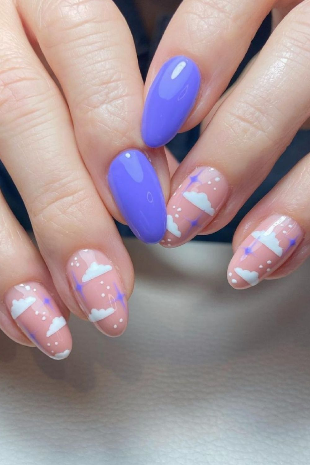 White clouds and blue almond nails art