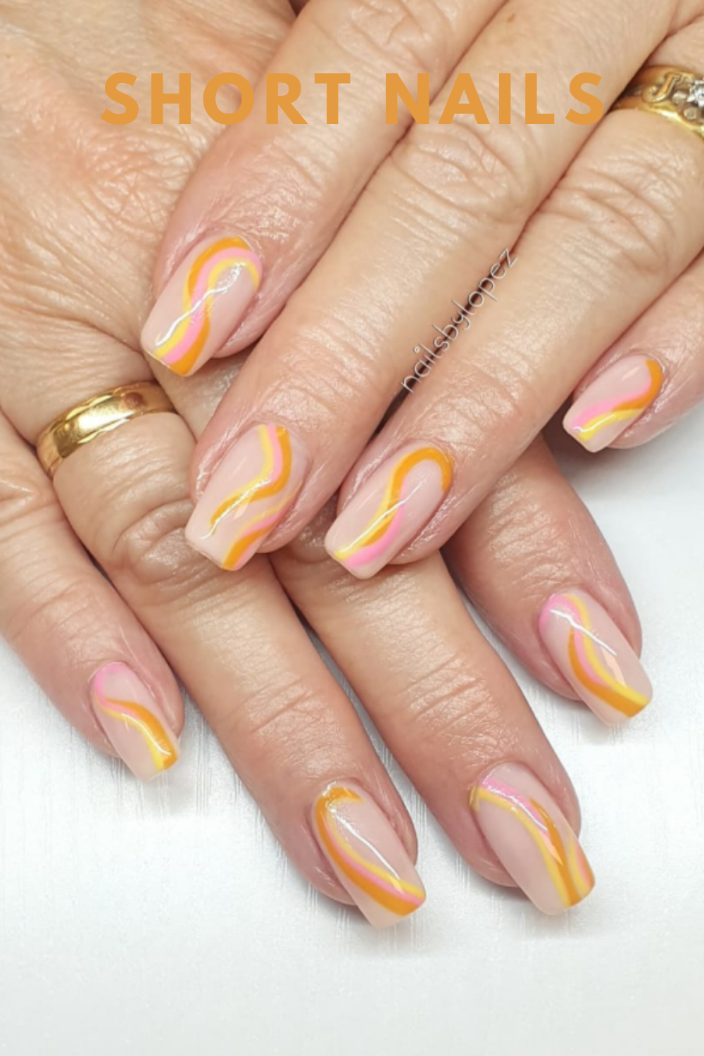 Short nail art designs with yellow and pink