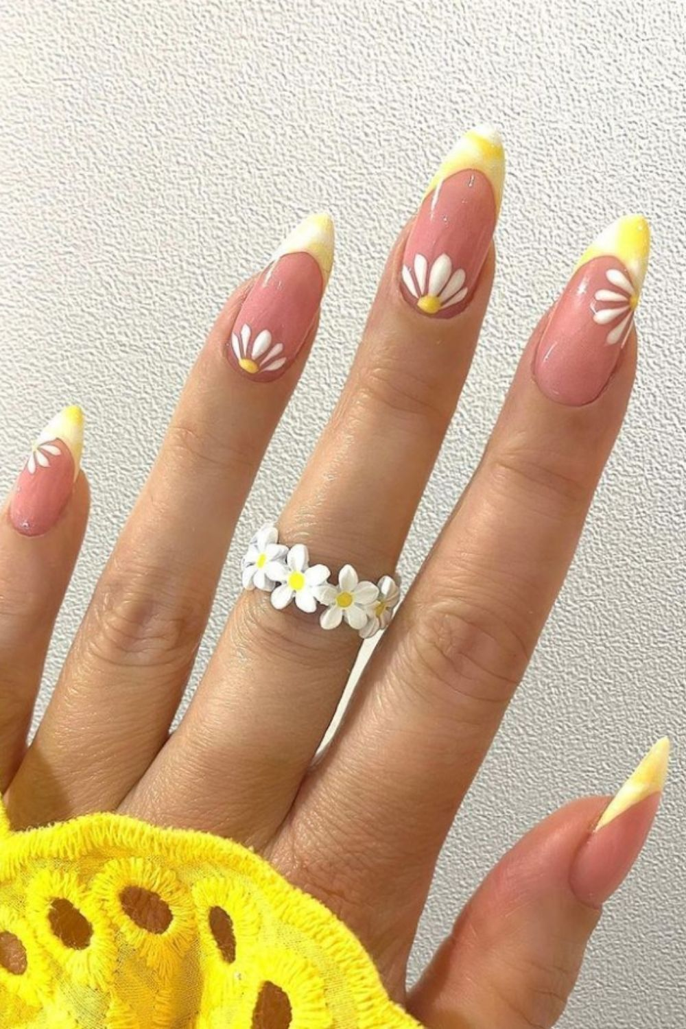 Flower and yellow tip acrylic almond nails design