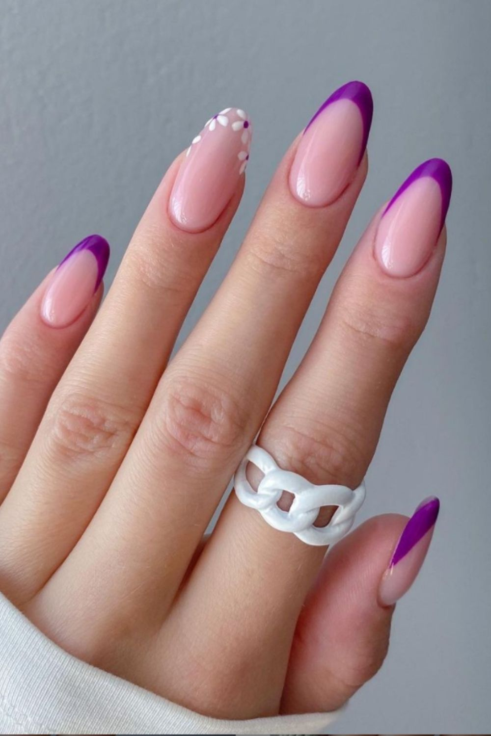 Flower and purple top almond nails