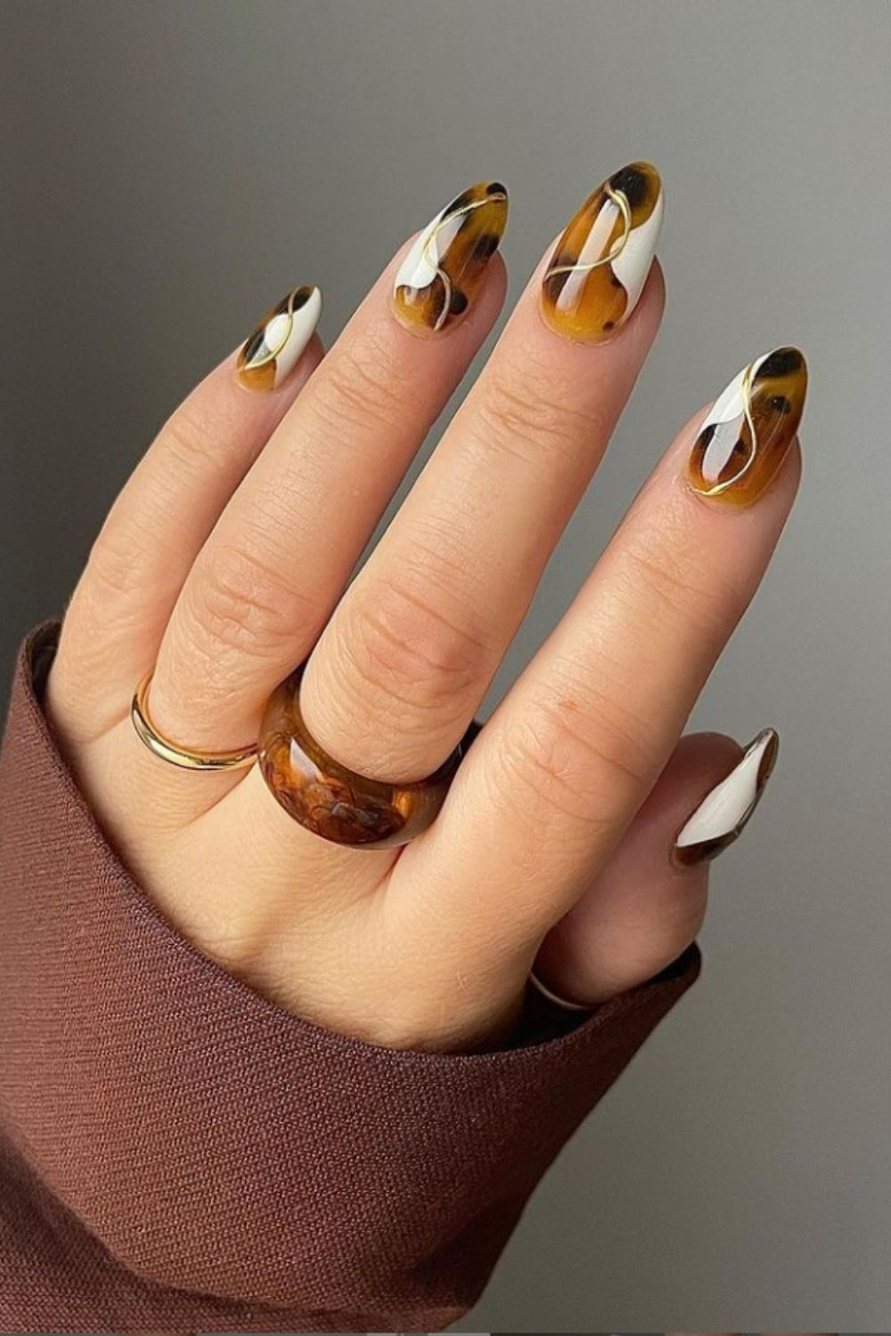 Brown and white almond nail design