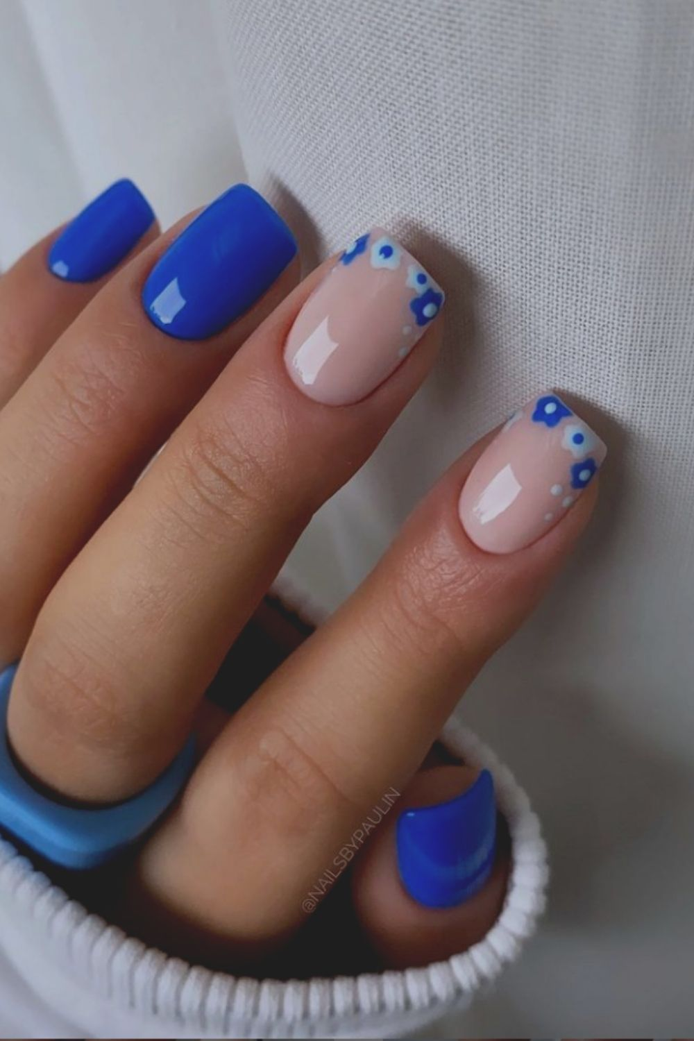Flower tip and blue Frebch nails