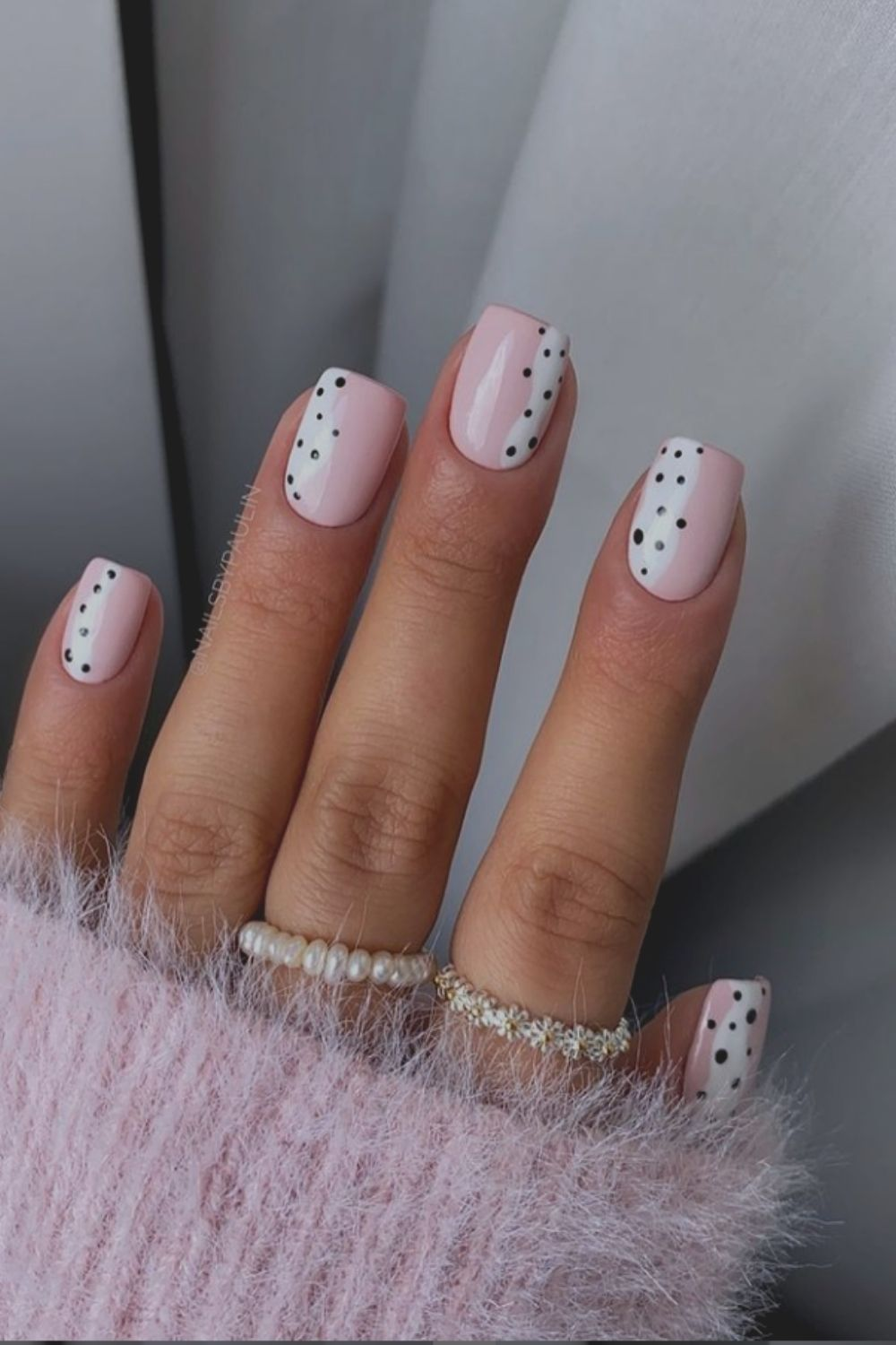 White and pink nails art with black dots