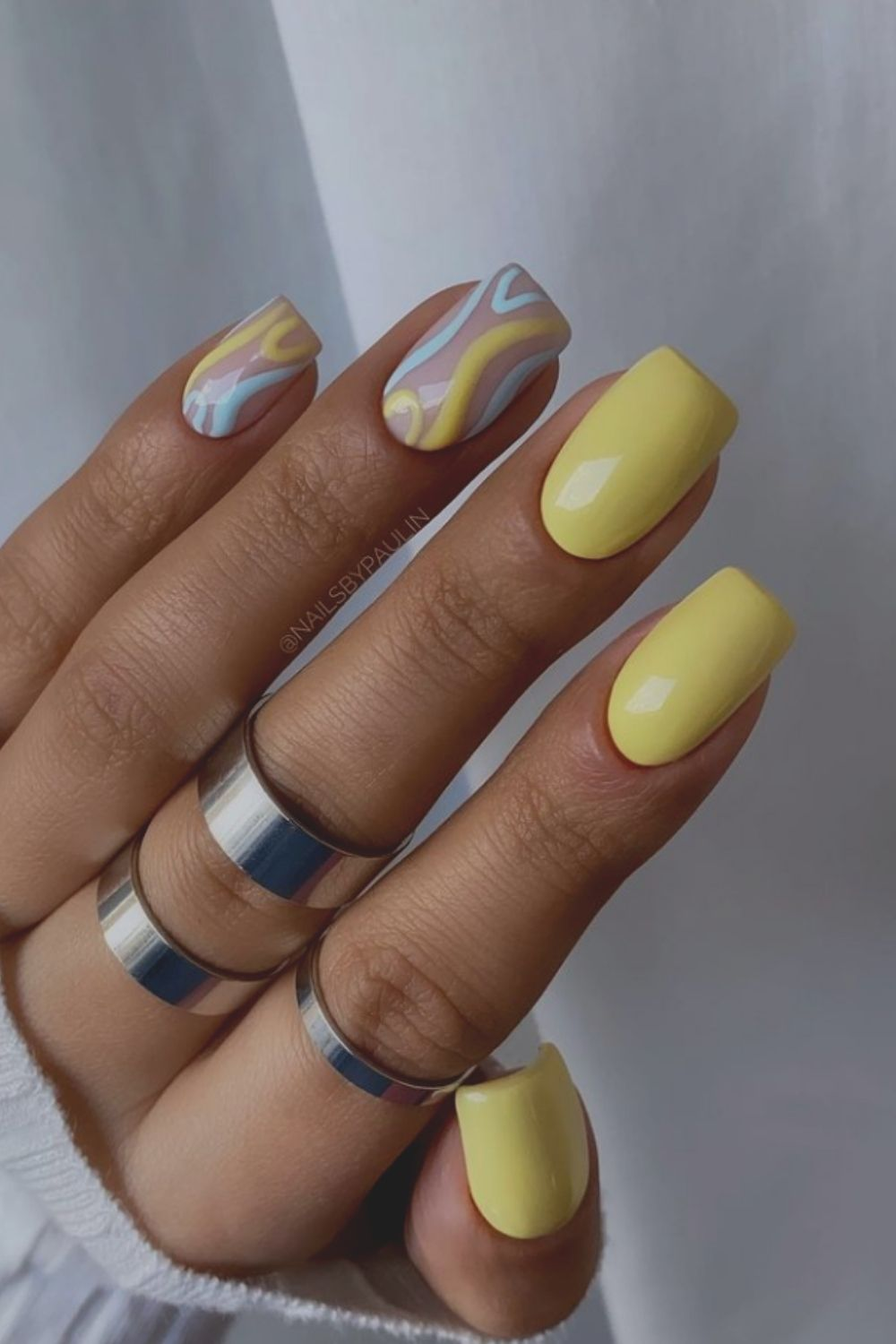 Yellow and light blue nails